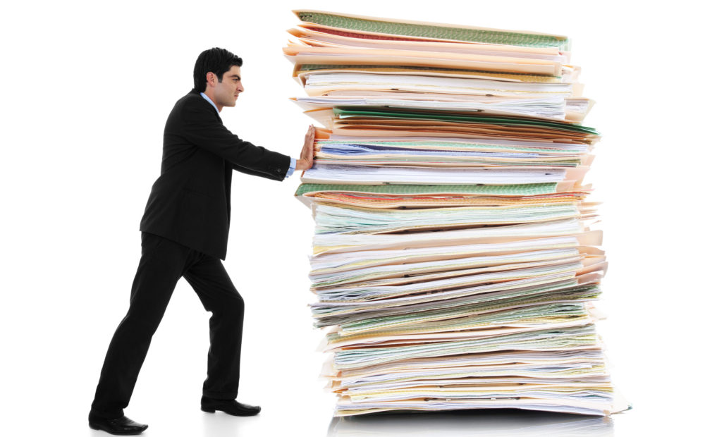 man pushing paper away to form a paperless property management office